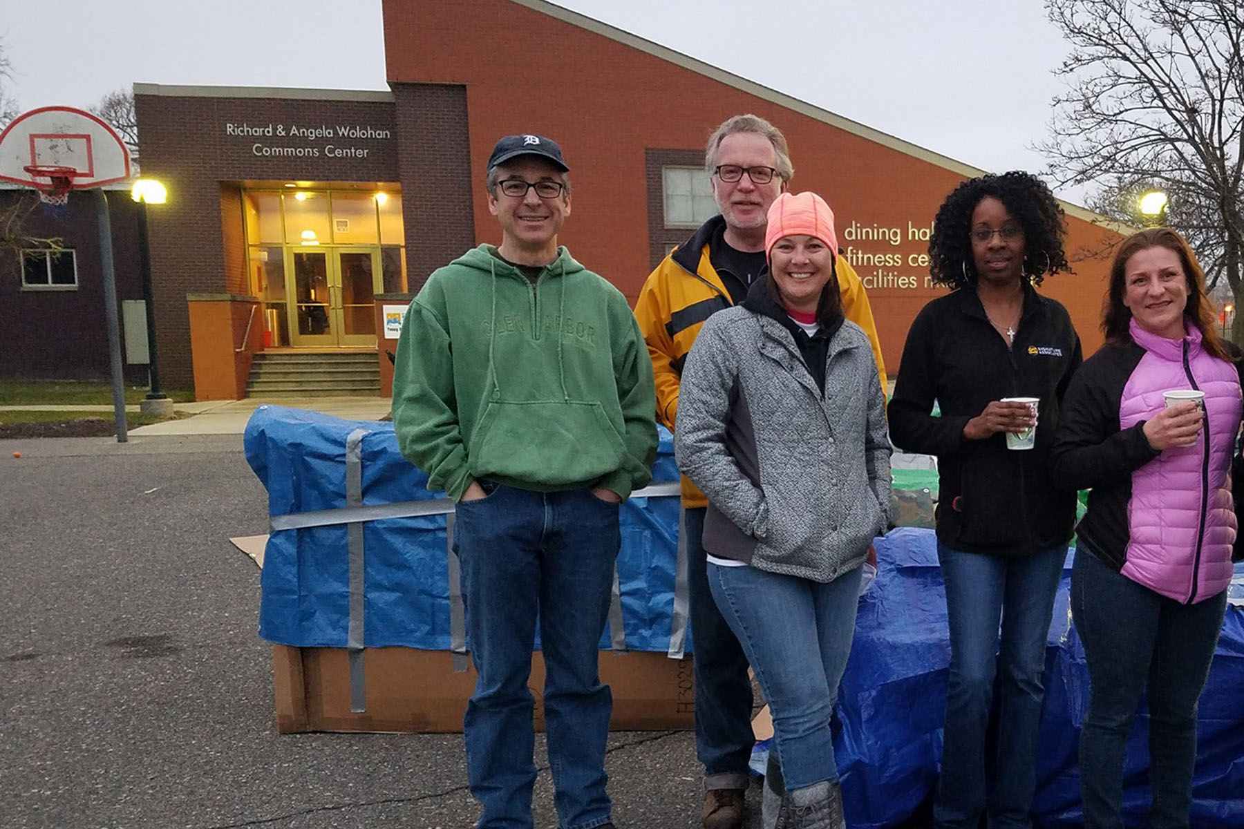 Assisting with clean-up after Covenant House Young Professional's Sleep Out