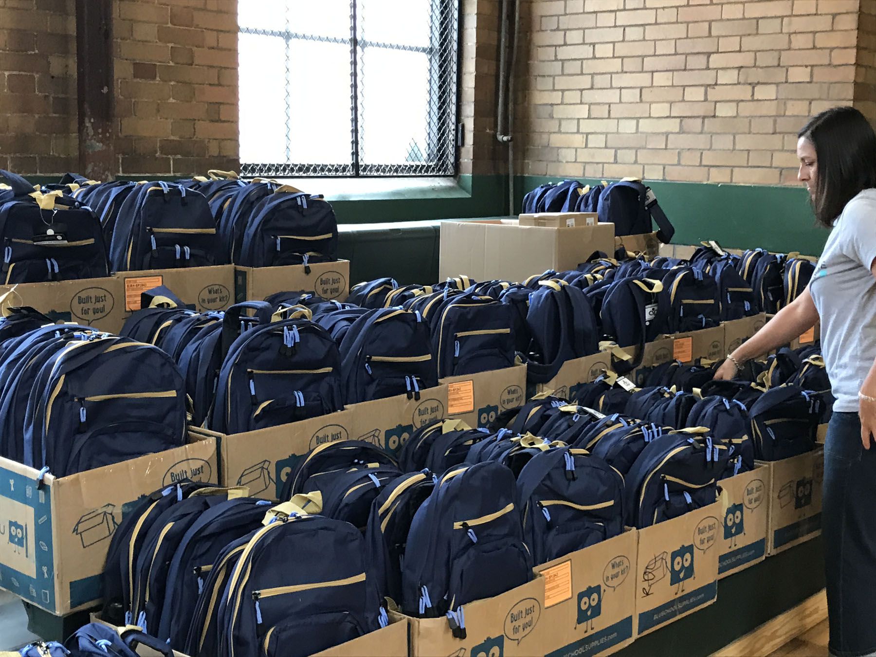 Detroit Cristo Rey students receiving their backpacks